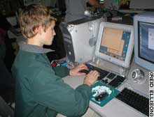 Reid Ellison, 15, works on a computer at school.