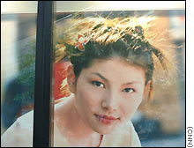 Models with pale faces can be seen on advertisments all along Hong Kong's busy shopping streets