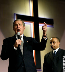 President Bush speaks at the First Baptist Church of Glenarden in Landover, Maryland. Looking on is Pastor John K. Jenkins.