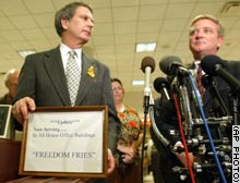Reps. Walter Jones, left, and Bob Ney announce the name changes on House menus at a Tuesday news conference.