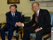 President Bush, right, greets President Rudolf Schuster of the Slovak Republic in the Oval Office of the White House on Wednesday.