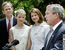 President Bush speaks in the Rose Garden as Elizabeth Smart and her parents look on.