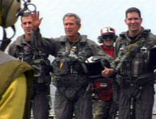 President Bush with pilots just after arriving on the USS Abraham Lincoln.