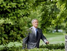 President Bush strides through the East Garden of the White House, where he spoke on behalf of legislation on forest management.