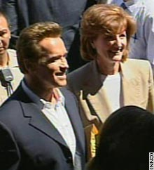 Schwarzenegger and Huffington arrive Saturday at the Los Angeles County Registrar's Office.