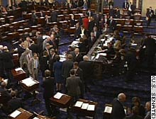 The Senate voted to convert half of President Bush's $20.3 billion Iraqi rebuilding plan into a loan.