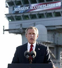 President Bush addresses the nation from aboard the USS Abraham Lincoln on May 1 with the banner in the background.