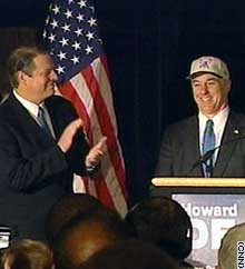 Al Gore applauds Howard Dean Tuesday at a rally in Manhattan's Harlem.
