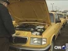 GAZ company's engineer tries to keep the Volga taxi motors in running order.
