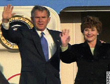 President George W. Bush and first lady Laura Bush arrive in Tokyo Friday.