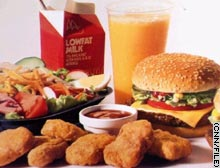 McDonald's said it would offer a special low-fat menu along with regular fare at Houston restaurants.