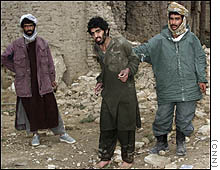 Hamdi, center, was captured in Afghanistan