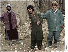 Hamdi, center, was captured in Afghanistan
