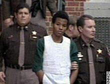 Lee Boyd Malvo, center