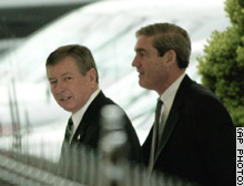 Attorney General John Ashcroft, left, and FBI Director Robert Mueller arrive at the White House for an intelligence meeting with President Bush earlier this week.