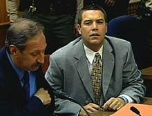 Scott Peterson, right, with defense attorney Mark Geragos.