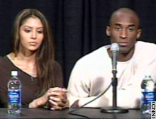 Kobe Bryant, with his wife, Vanessa, speaks Friday after being charged with sexual assualt. He denied the accusation.
