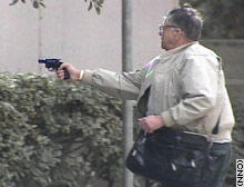 A gunman is pictured Friday outside the courthouse where a hearing for Robert Blake was being held.