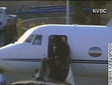 Michael Jackson gets off a charter jet in Las Vegas, Nevada, last Thursday, where he returned after flying to Santa Barbara to answer the arrest warrant.