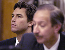 Scott Peterson listens during his arraignment Wednesday.