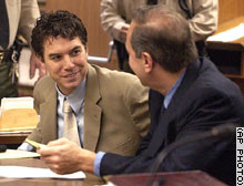 Scott Peterson, left, and defense attorney Mark Geragos talk during a hearing in Modesto last Friday.