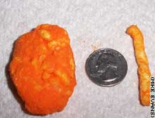 The giant Chee-to shown next to a quarter and a regular-sized Chee-to.