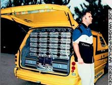 Troy Irving and his Dodge Caravan, which has 72 daisy-chained Ample Audio 1500 DX amps