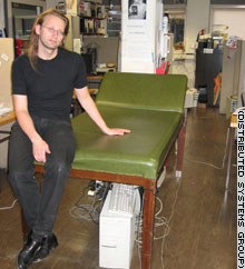 Scientist Mads Haahr sitting on his talking sofa.
