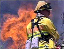 A fireman fights a wildfire in Colorado in 2002.
