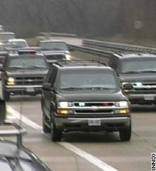 The president's motorcade returns from Camp David to Washington.
