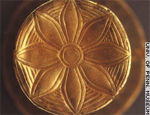 This is the bottom of a Mesopotamian tumbler fashioned from gold and silver. It's one of many ancient works of art found in Iraq on display at the University of Pennsylvania Museum.
