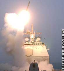 The first of a volley of cruise missiles is launched from the USS Bunker Hill in the Persian Gulf.
