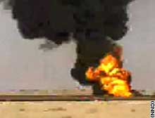 Fire rages Friday at an oil field in southern Iraq.