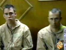 Chief Warrant Officers Ronald D. Young Jr., left, and David S. Williams were filmed after their capture.