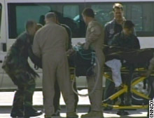 The first injured U.S. troops arrive at Ramstein Air Base in Germany.