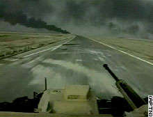 Smoke rising from Basra is visible from a British armored vehicle approaching the city Tuesday.