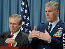 Rumsfeld and Myers talk to reporters at the Pentagon.
