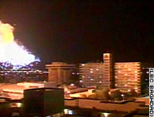 Blasts lit up the night sky over Baghdad late Saturday.