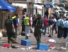 Emergency workers survey the scene of the blast.