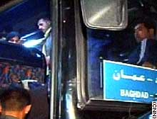 Passengers board a bus heading to Baghdad, after stopping on the way at Abu Saif's for supper.