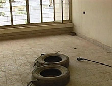 The old tires protected the torturer while the victim stood on a wet floor and was electrocuted, a BBC reporter was told.