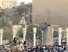 Crowds cheer as a statue of Saddam Hussein falls.