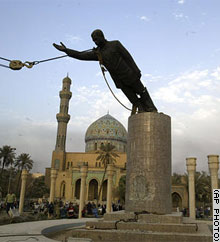 The landmark statue of Saddam Hussein in Baghdad's Firdos Square is brought down Wednesday by Iraqis and U.S. Marines.