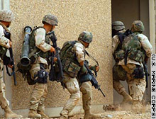 Marines enter a building during an April 8 raid on a compound in Iraq.