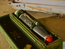 This suspected chemical warhead discovered at an air base near Kirkuk is marked with a green band, which sources said is the symbol for chemical weaponry.