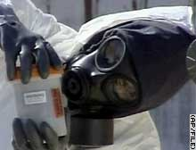 A U.N. weapons inspector takes chemical samples at Iraq's Al Muthanna facility in February.