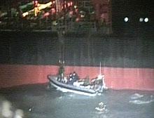 British Navy officials board the Navstar 1 Friday.