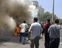 A vehicle burns in Gaza City after Thursday's Israeli missile attack.