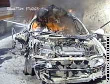 A car burns Monday in Gaza City after a missile strike.