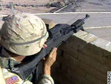 A U.S. soldier on alert at a border lookout in Iraq.